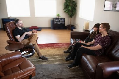 couples sitting on couch at LifeWise in marriage therapy with Dr David Helfand Psy D