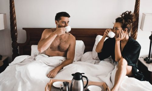happy couple drinking tea after great sex